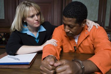 depositphotos_21972613-stock-photo-lawyer-consoling-criminal